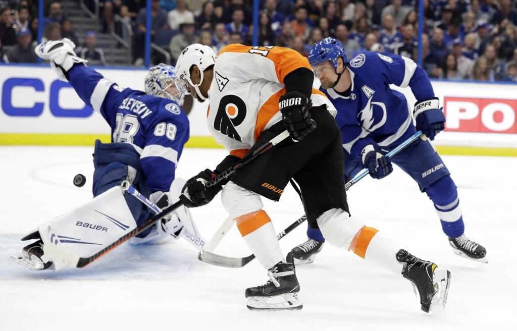 Philadelphia Flyers right wing Wayne Simmonds (17) has his shot stopped by Tampa Bay Lightning goaltender Andrei Vasilevskiy (88) and defenseman Anton...