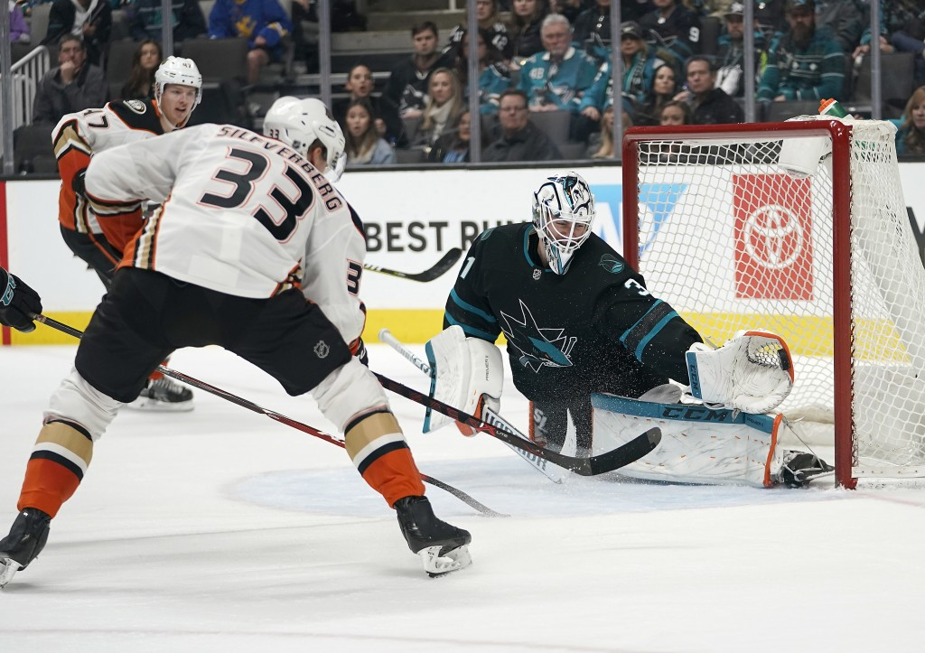 San Jose Sharks goaltender Martin Jones (31) makes a glove save on a shot by Anaheim Ducks right wing Jakob Silfverberg (33) during the second period ...