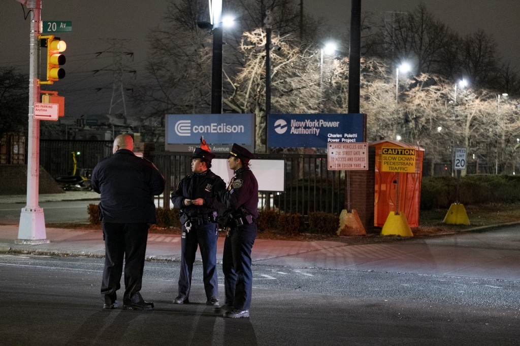 New York Police Department officers stand in front of a Con Edison facility in the Queens borough of New York, Thursday, Dec. 27, 2018, where an earli...