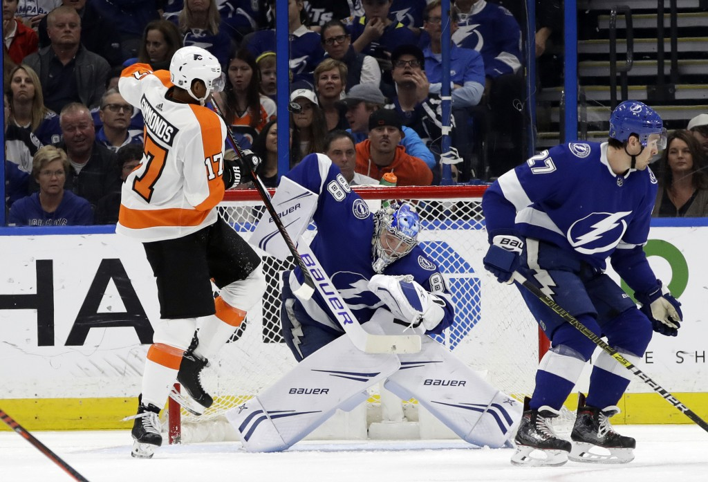 Philadelphia Flyers right wing Wayne Simmonds (17) tries to deflect the puck past Tampa Bay Lightning goaltender Andrei Vasilevskiy (88) during the se...