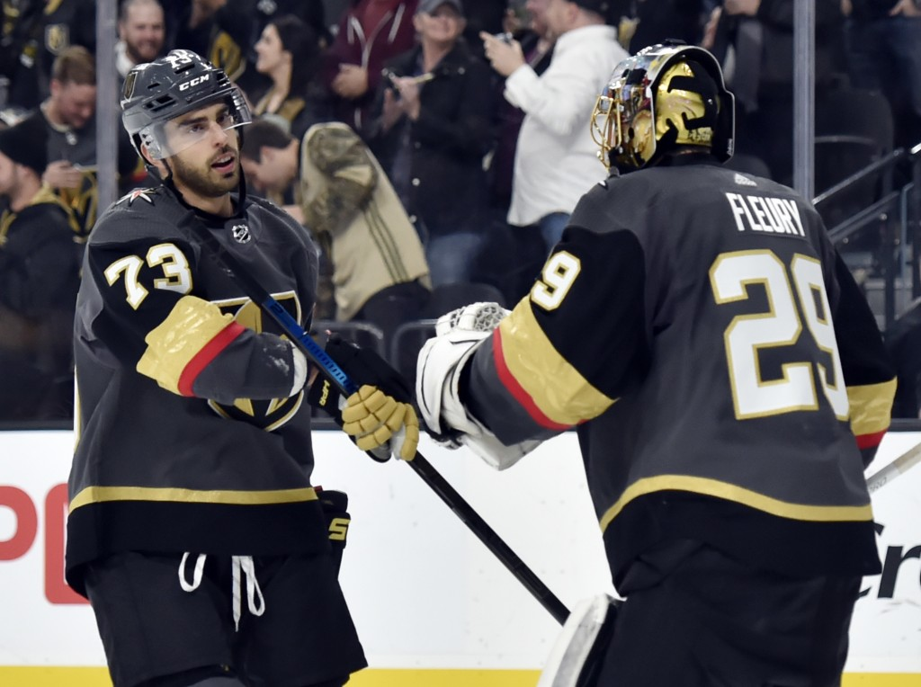 Vegas Golden Knights forward Brandon Pirri (73) gives goaltender Marc-Andre Fleury a fist bump after scoring against the Colorado Avalanche during the...
