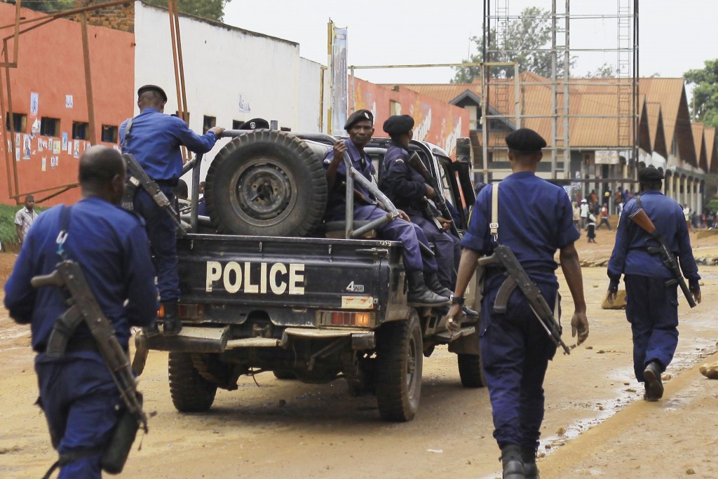 Congolese police move to quell protests in the Eastern Congolese town of Beni, Friday Dec. 28, 2018, as they demonstrate against the election postpone...