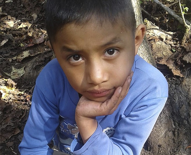 This Dec, 12, 2018 photo provided by Catarina Gomez on Thursday, Dec. 27, 2018, shows her stepbrother Felipe Gomez Alonzo, 8, near her home in Yalambo...