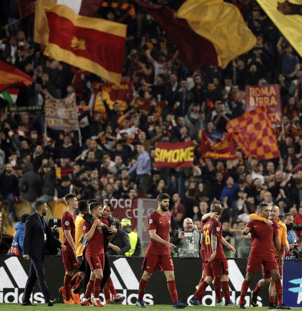 FILE - In this April 10, 2018, file photo, Roma player celebrate at the end of the Champions League quarterfinal second-leg soccer match against FC Ba...