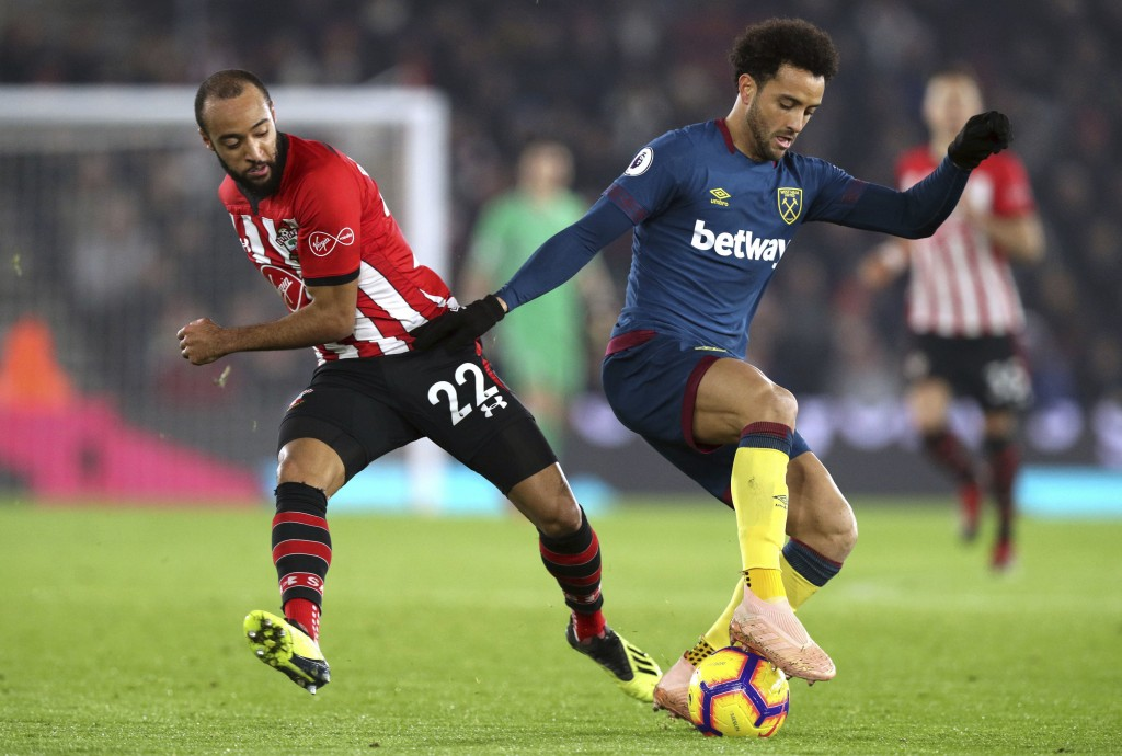 Southampton's Nathan Redmond, left and West Ham United's Felipe Anderson battle for the ball during the English Premier League soccer match between So...