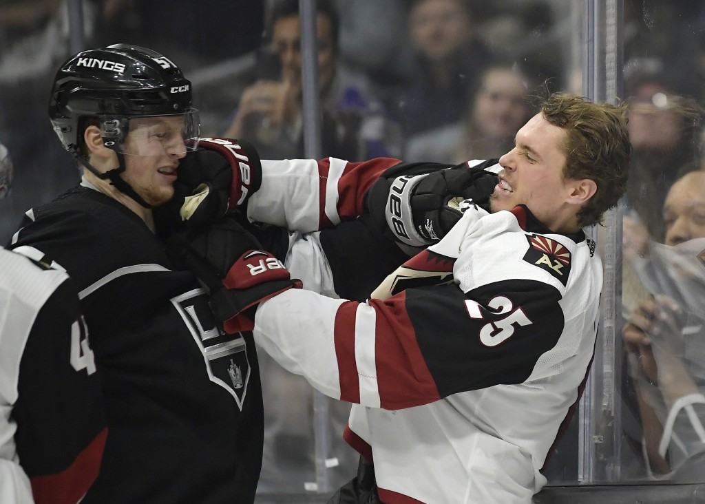 Los Angeles Kings left wing Austin Wagner, left, and Arizona Coyotes center Nick Cousins tangle during the second period of an NHL hockey game Thursda...