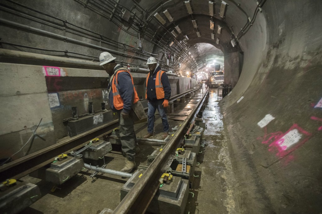 In this Nov. 29, 2018 photo, a construction crew works on the tracks of the East Side Access project beneath Grand Central Terminal in New York. The s...