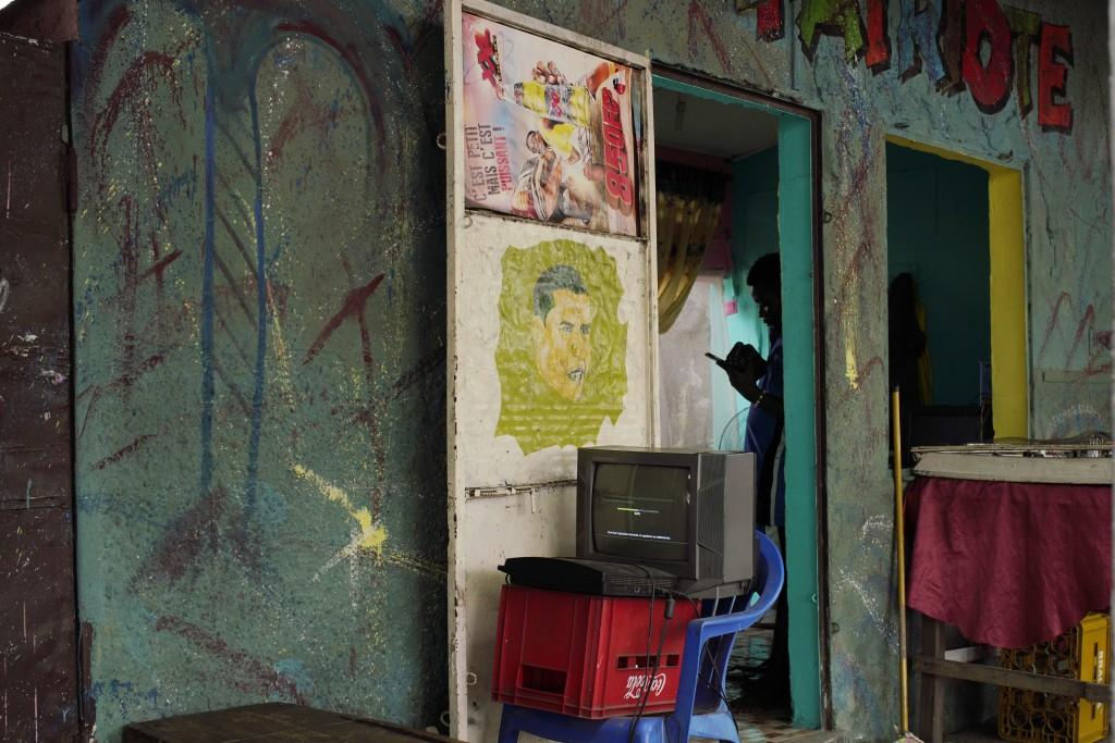 A hairdresser waits for customers in Kinshasa, Congo, Friday Dec. 28, 2018.  Congo's leader Joseph Kabila has blamed a deadly Ebola virus outbreak for...