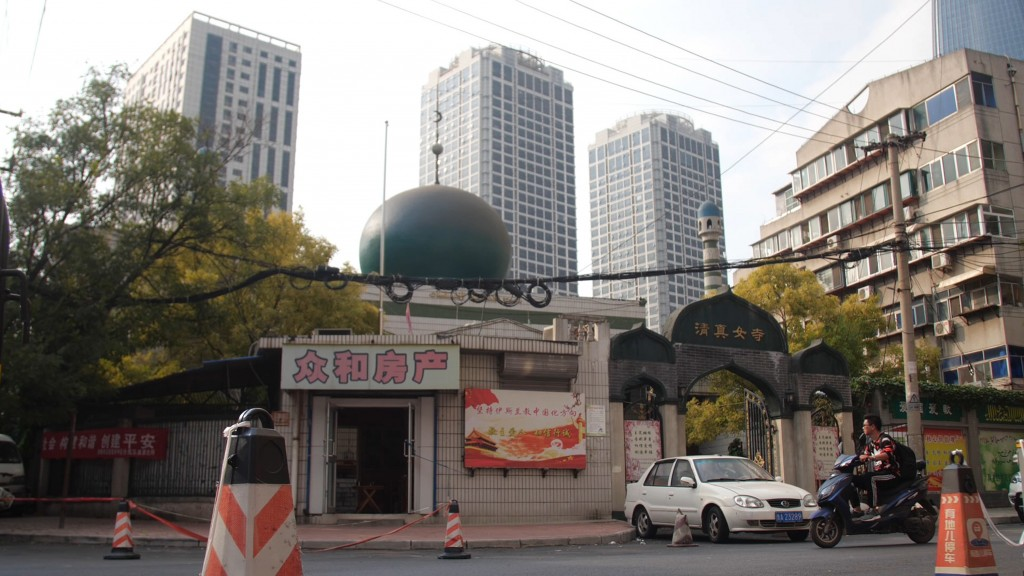 In this Sept. 28, 2018, photo, a motorcyclist passes by the Nandashi Great Southern Mosque, built in the 15th century in Jinan in China's eastern prov...