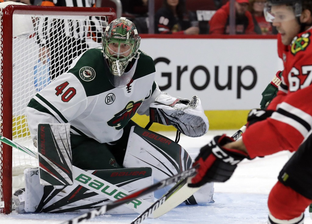Minnesota Wild goalie Devan Dubnyk (40) watches the puck during the first period of an NHL hockey game against the Chicago Blackhawks, Thursday, Dec. ...
