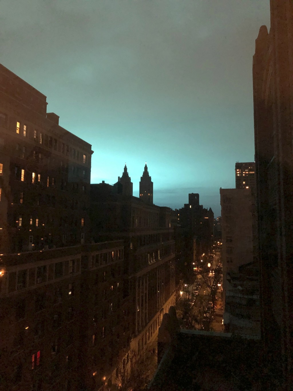 This photo shows blue light over New York, as seen from Manhattan Brough of New York on Thursday, Dec. 27, 2018. New York police said a transformer ex...