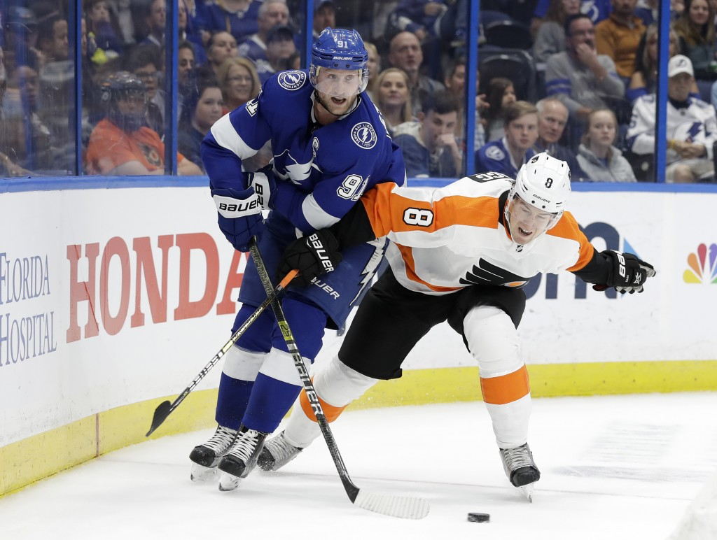 Tampa Bay Lightning center Steven Stamkos (91) and Philadelphia Flyers defenseman Robert Hagg (8) compete for the puck during the second period of an ...
