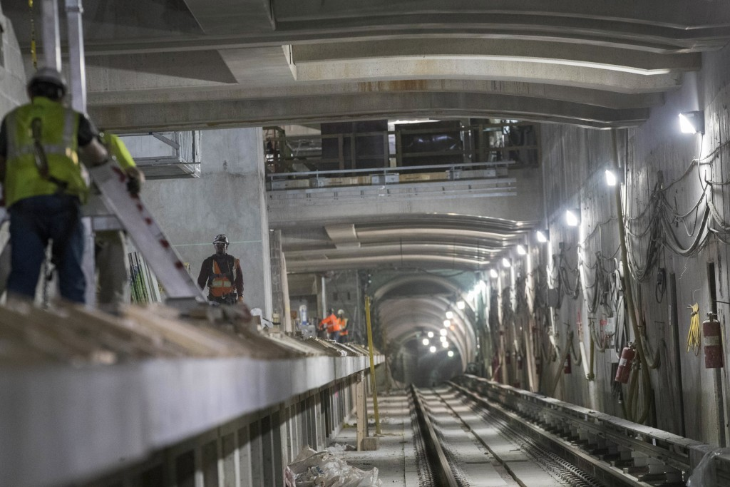 In this Nov. 29, 2018 photo, construction crews work on a track platform of the East Side Access project beneath Grand Central Terminal in New York. (...