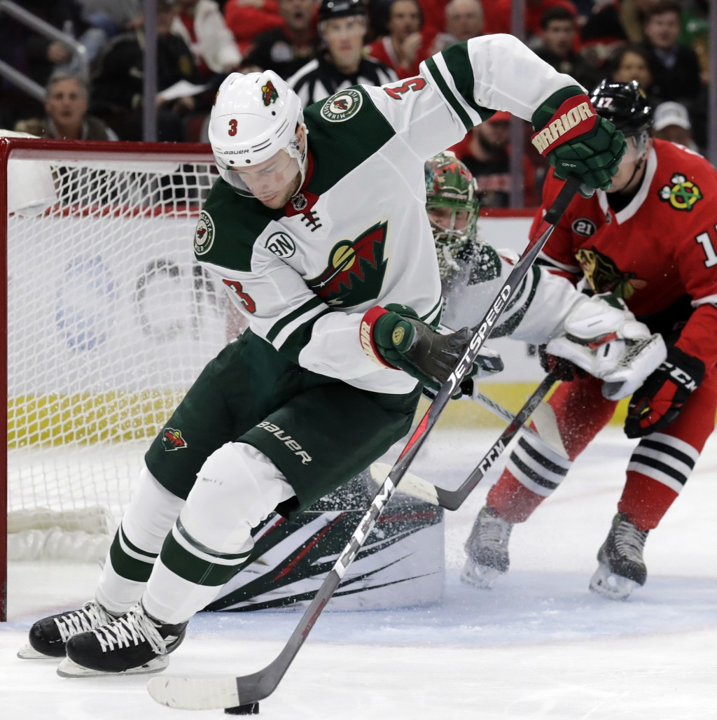 Minnesota Wild center Charlie Coyle (3) controls the puck against the Chicago Blackhawks during the first period of an NHL hockey game Thursday, Dec. ...