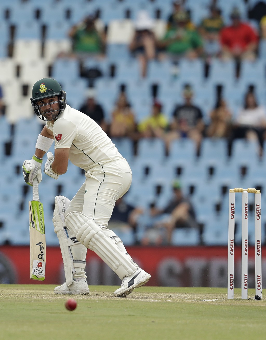South Africa's batsman Dean Elgar watches his shot on day three of the first cricket test match between South Africa and Pakistan at Centurion Park in...