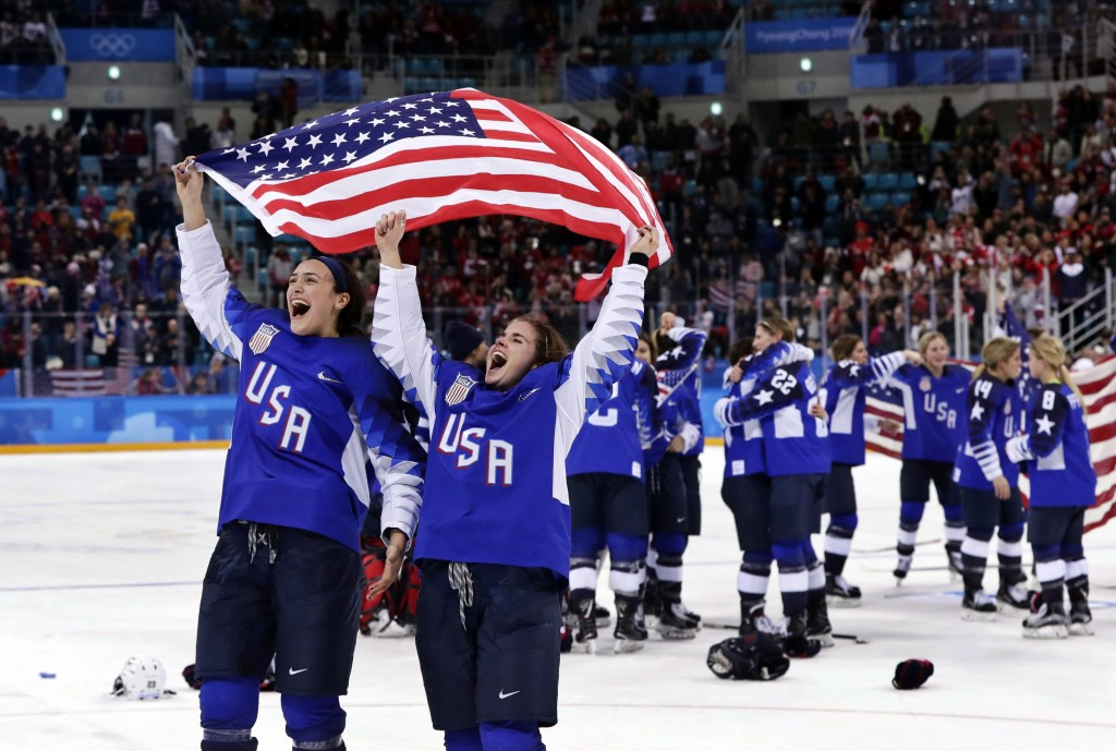 FILE - In this Feb. 22, 2018, file photo,  United States players celebrate after winning the women's gold medal hockey game against Canada at the 2018...
