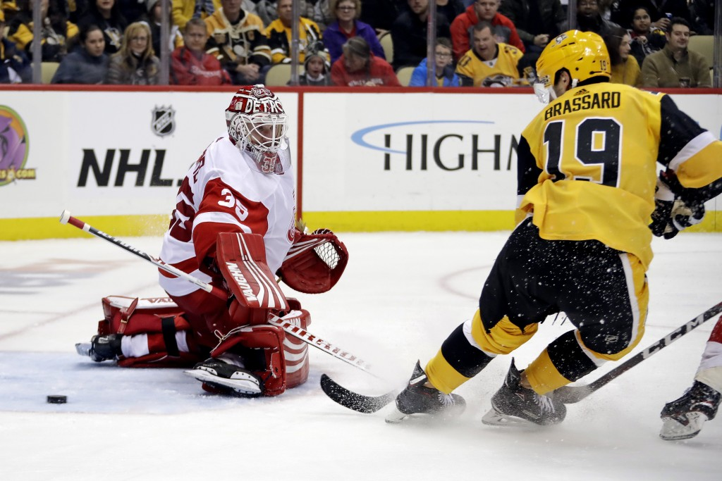 Pittsburgh Penguins' Derick Brassard (19) deflects the puck past Detroit Red Wings goaltender Jimmy Howard (35) for a goal during the second period of