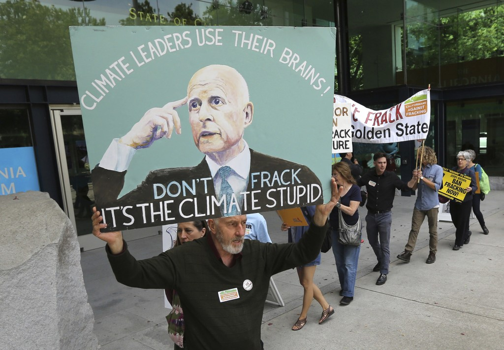 FILE - In this May 19, 2014, file photo, Richard Gray joins others in a demonstration calling on Gov. Jerry Brown to end hydraulic fracturing for oil ...
