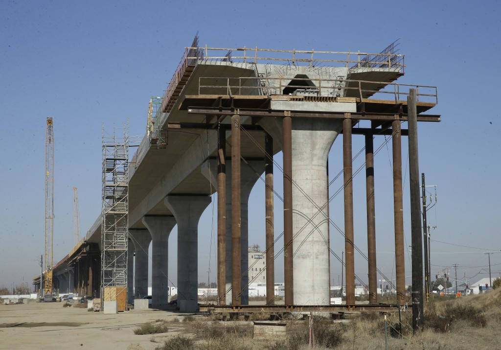 FILE - This Wednesday, Dec. 6, 2017, file photo, shows one of the elevated sections of the high-speed rail under construction in Fresno, Calif. Gov. J