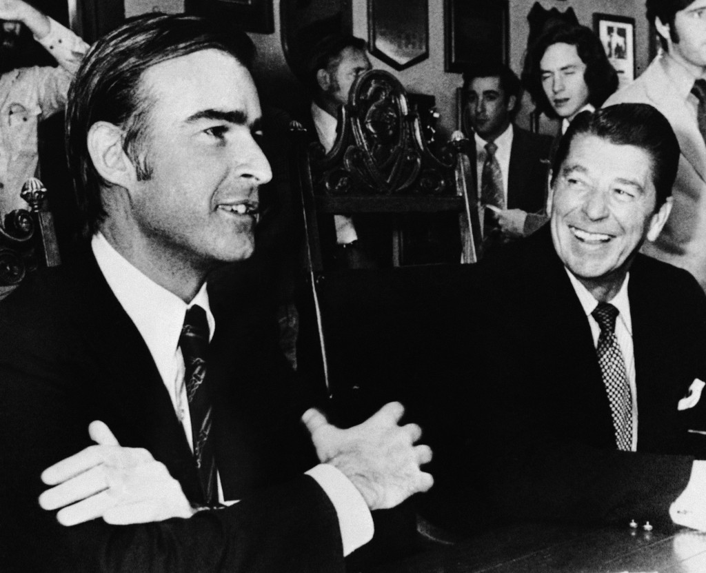 FILE - In this Nov. 8, 1974, file photo, Democratic Gov.-elect Edmund G. Brown Jr., left, and Republican Gov. Ronald Reagan pose for photographers at