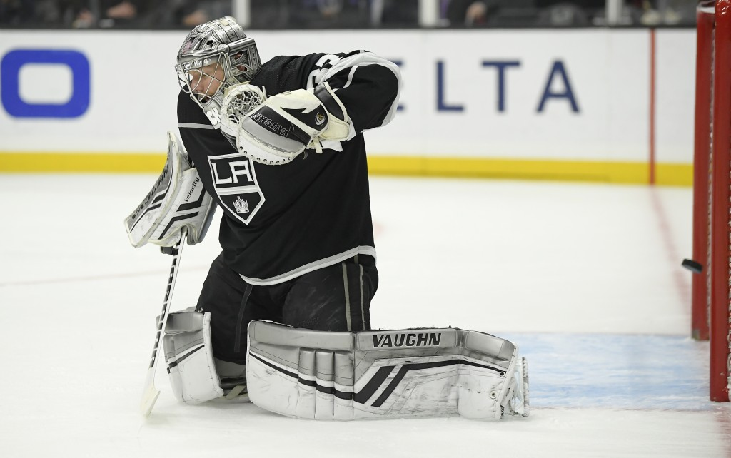 Los Angeles Kings goaltender Jonathan Quick gives up a goal to Arizona Coyotes defenseman Jakob Chychrun during the first period of an NHL hockey game...