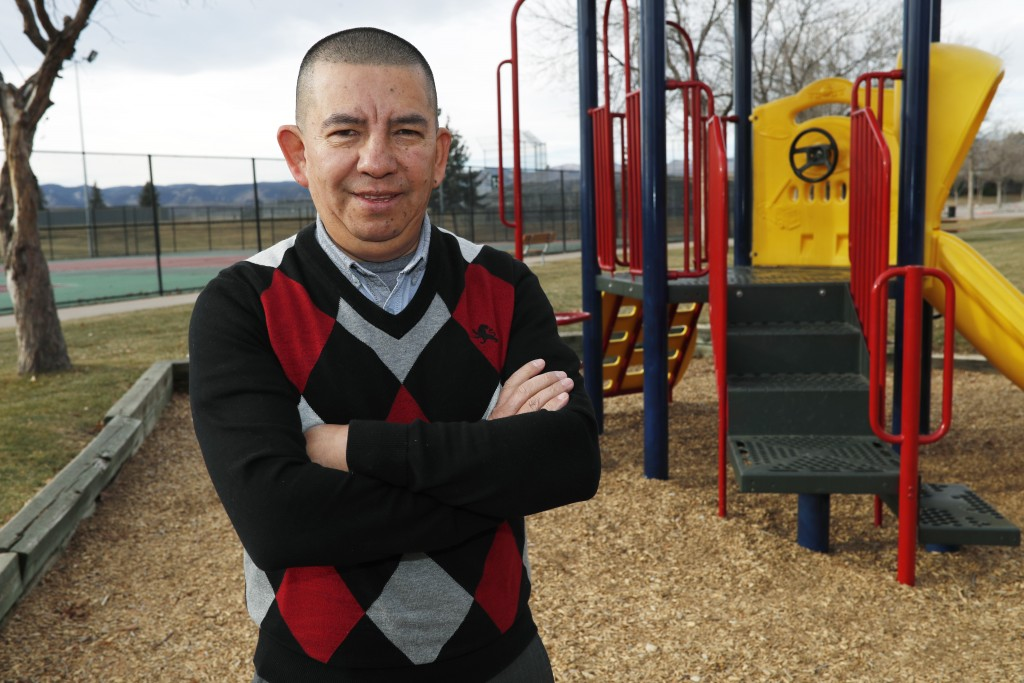 FILE - In this, Dec. 15, 2018, file photo, Pedro H. Gonzalez, the bi-vocational Denver pastor and board member of Colorado Family Action, poses for a ...