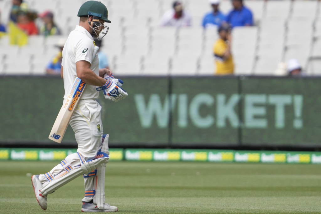 Australia's Aaron Finch walks off the field after being caught out for 8 runs during play on day three of the third cricket test between India and Aus...