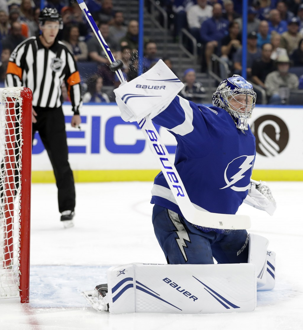 Tampa Bay Lightning goaltender Andrei Vasilevskiy (88) makes a blocker save on a shot by the Philadelphia Flyers during the first period of an NHL hoc...