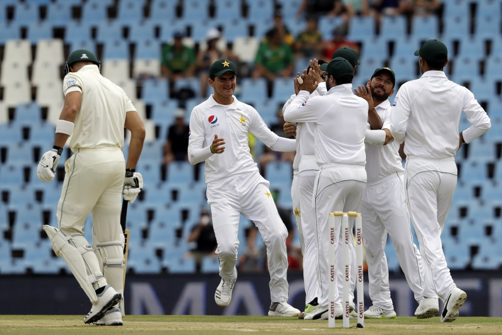 Pakistan's players celebrate the dismissal of South Africa's batsman Aiden Markram, left, for a duck on day three of the first cricket test match betw...