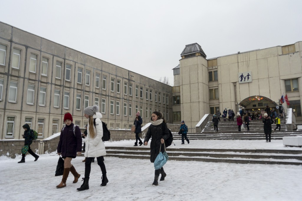 In this photo taken on Thursday, Dec. 20, 2018, students come out of the school building in St. Petersburg, Russia. Two Russian high school students, ...
