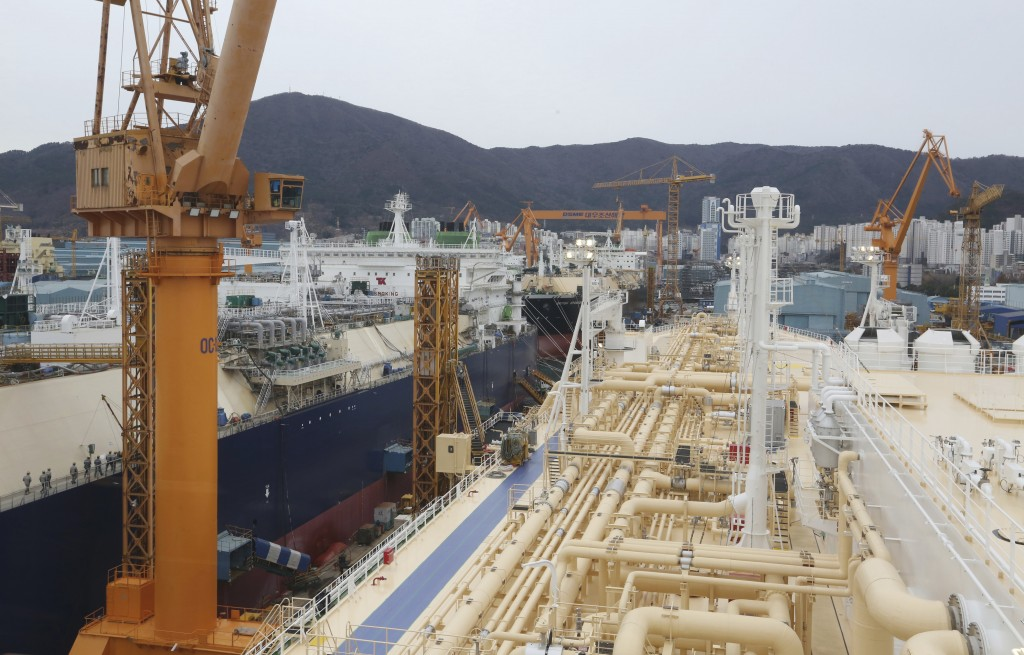 In this Friday, Dec. 7, 2018 photo, liquefied natural gas (LNG) carriers are being constructed at the Daewoo Shipbuilding and Marine Engineering facil...
