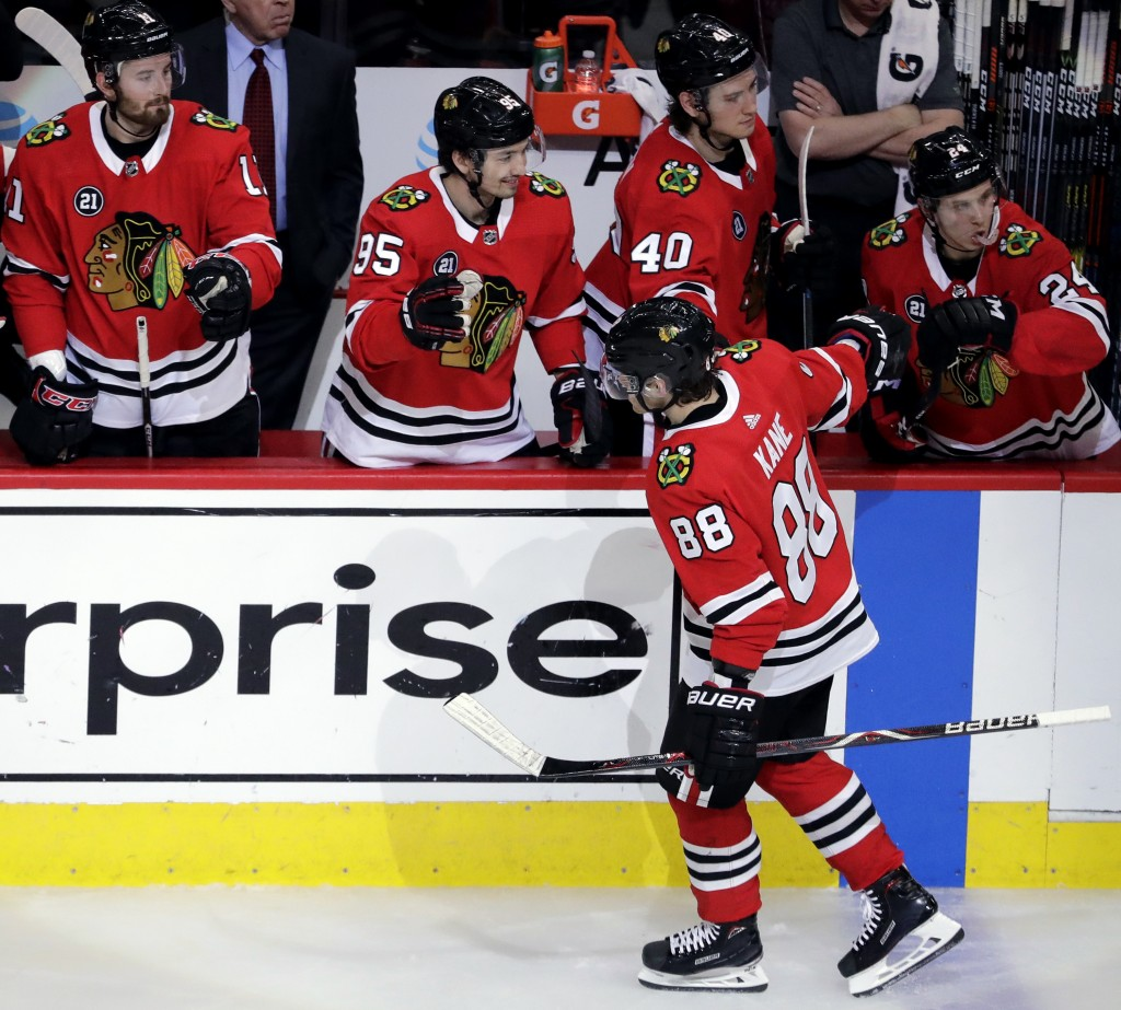 Chicago Blackhawks right wing Patrick Kane (88) celebrates with teammates after scoring his second goal during the second period of an NHL hockey game...