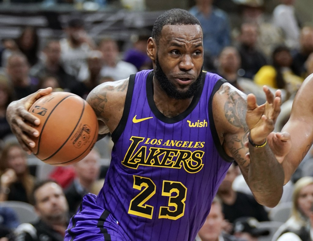 FILE - In this Dec. 7, 2018, file photo, Los Angeles Lakers' LeBron James (23) drives against the San Antonio Spurs during the first half of an NBA ba...