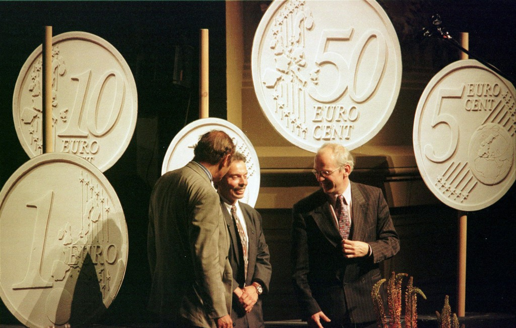 FILE - In this Monday, June 16, 1997 file photo, Belgian designer Luc Luycx, centre, is surrounded by the new Euro coins he designed during a presenta...
