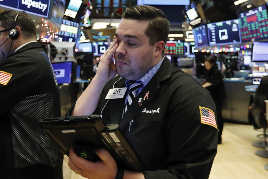 Trader Joseph Lawler works on the floor of the New York Stock Exchange at the closing bell, Thursday, Dec. 27, 2018. U.S. stocks staged a furious late
