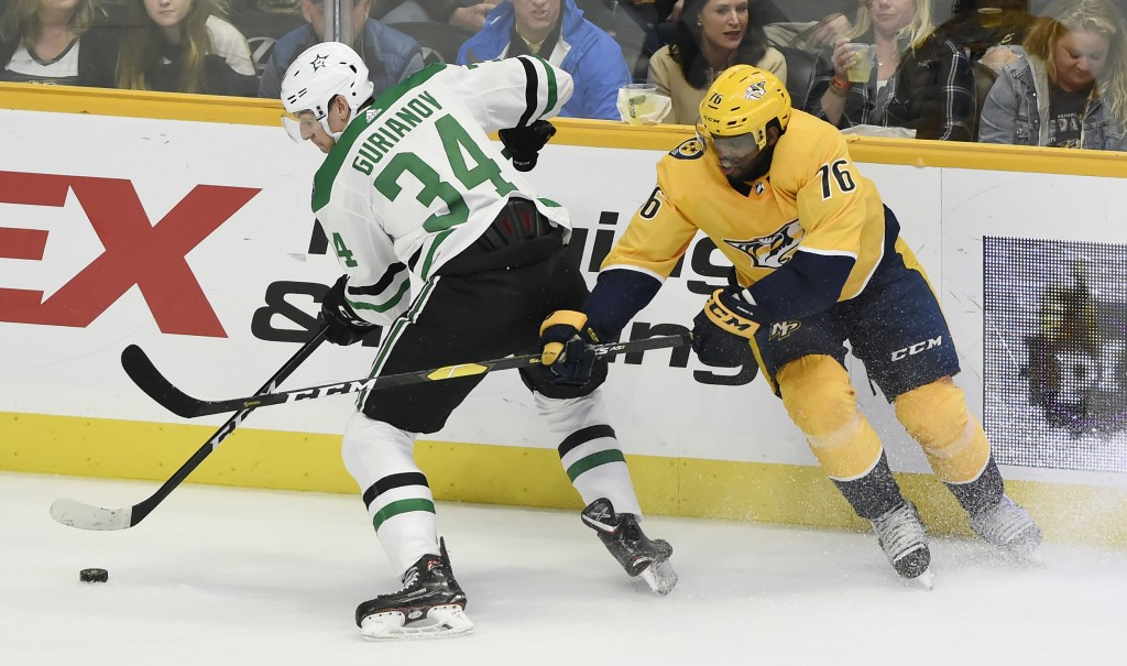 Dallas Stars right wing Denis Gurianov (34), of Russia, moves the puck away from Nashville Predators defenseman P.K. Subban (76) during the first peri...