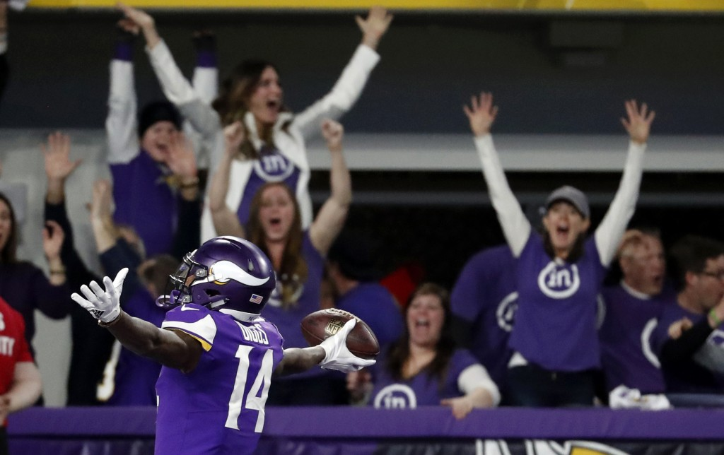 FILE - In this Jan. 14, 2018, file photo, Minnesota Vikings wide receiver Stefon Diggs (14) celebrates in the end zone after a making the game-winning...