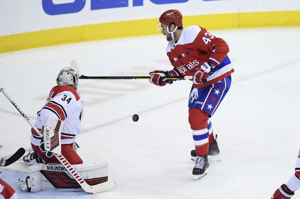 Washington Capitals right wing Tom Wilson (43) battles for the puck against Carolina Hurricanes goaltender Petr Mrazek (34) during the third period of...