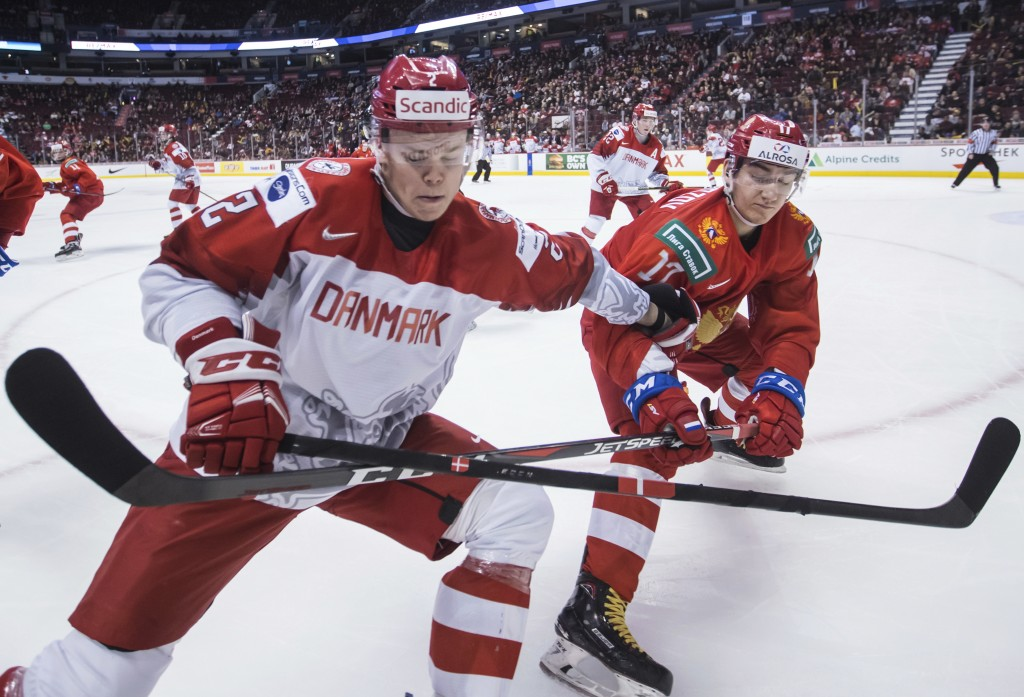 Denmark's Magnus Koch, left, and Russia's Ivan Morozov vie for the puck during the third period of a world junior hockey championship game Thursday, D