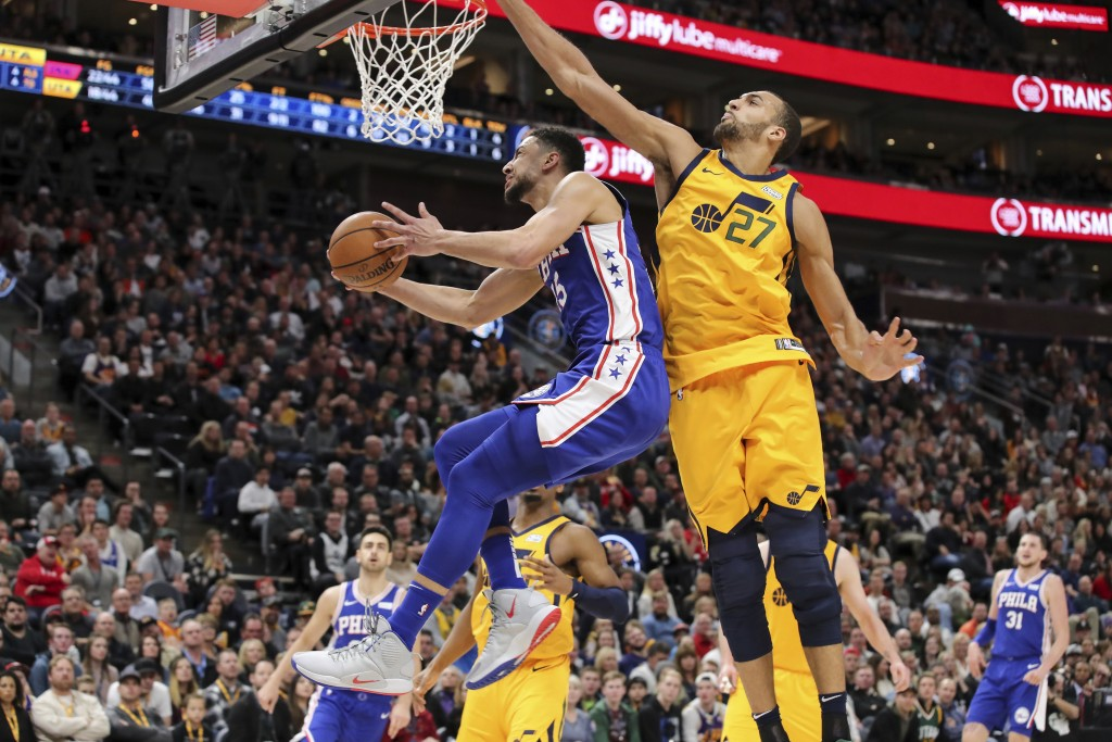 Philadelphia 76ers guard Ben Simmons (25) gets past Utah Jazz center Rudy Gobert (27) and looks to the basket during the second quarter of an NBA bask...