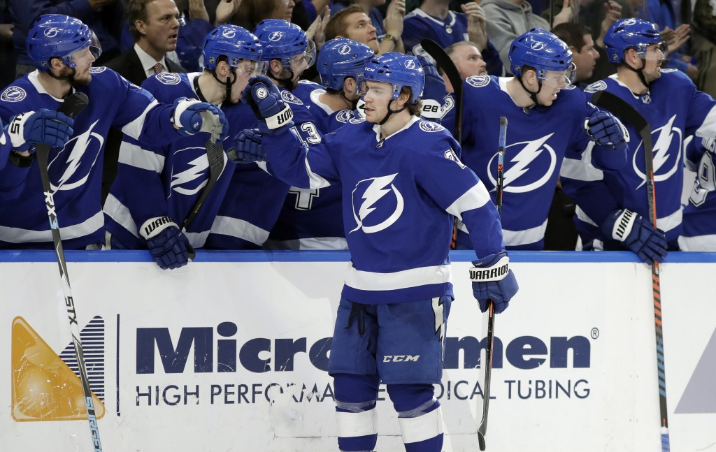 Tampa Bay Lightning center Brayden Point (21) celebrates with the bench after scoring against the Philadelphia Flyers during the first period of an NH...