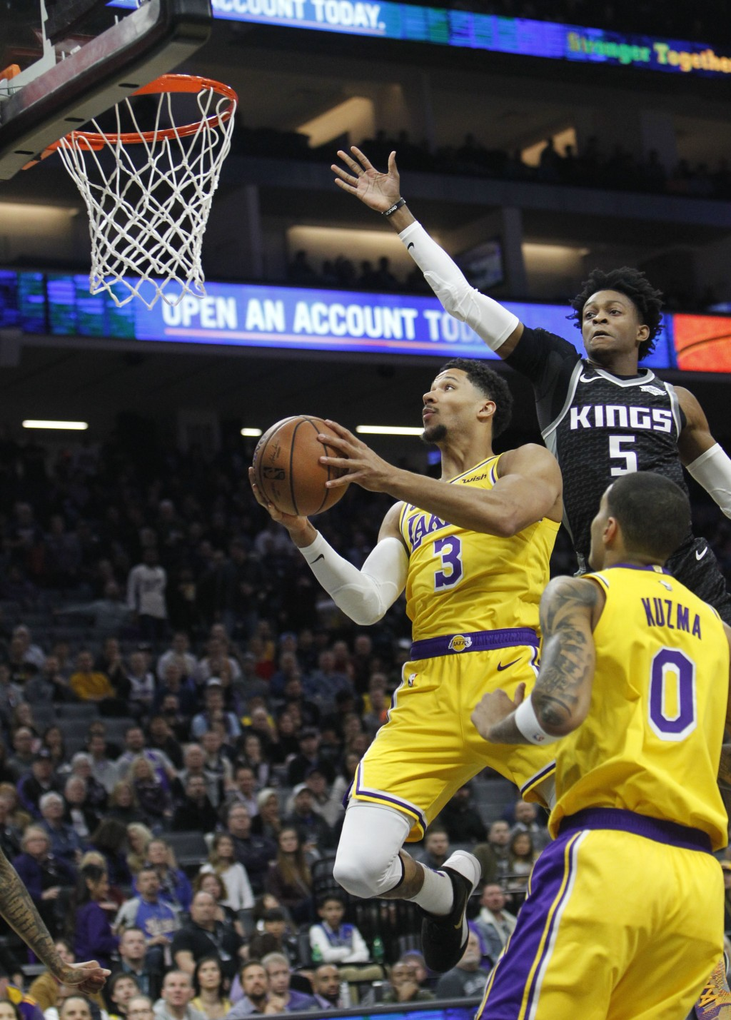 Los Angeles Lakers guard Josh Hart (3) drives to the basket as Sacramento Kings guard De'Aaron Fox (5) defends during the first half of an NBA basketb...