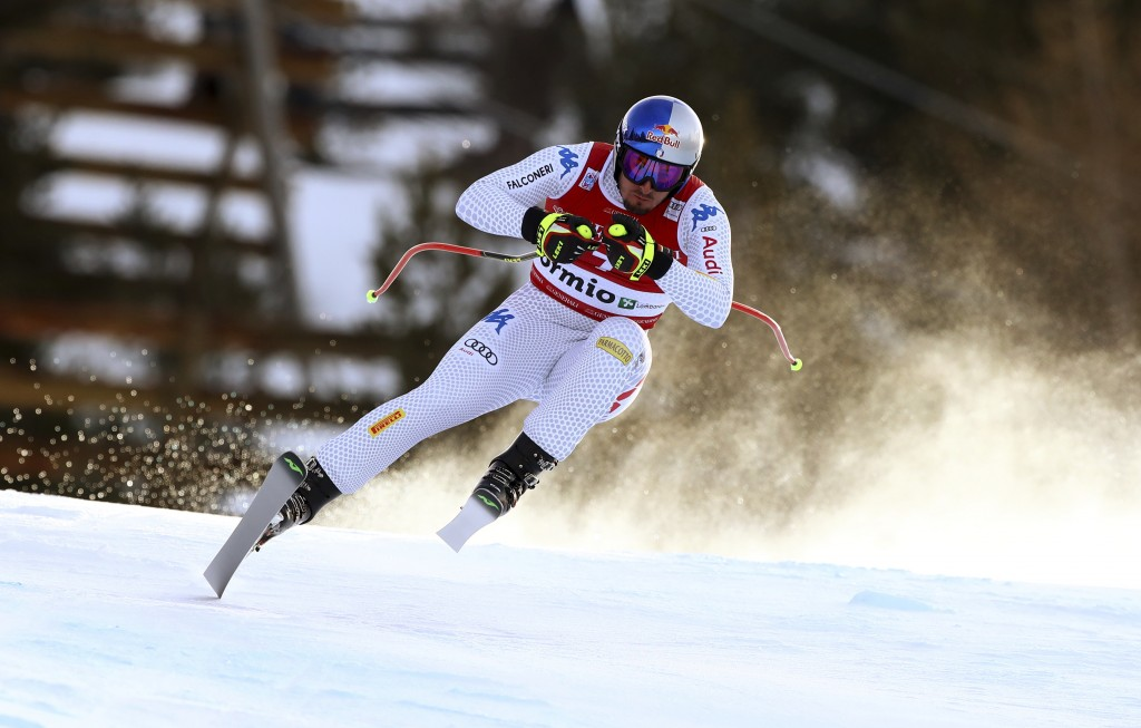 Italy's Dominik Paris speeds down the course during a ski World Cup Men's Downhill in Bormio, Italy, Friday, Dec.28, 2018. (AP Photo/Alessandro Trovat...