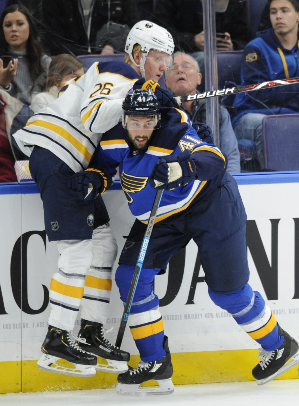 Buffalo Sabres' Rasmus Dahlin (26), of Sweden, is checked by St. Louis Blues' Robert Bortuzzo (41) during the first period of an NHL hockey game, Thur...