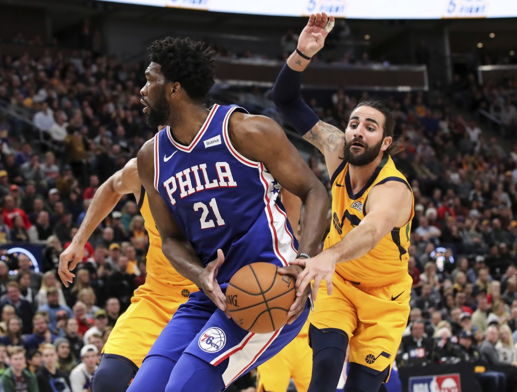 Utah Jazz guard Ricky Rubio tries to steal the ball from Philadelphia 76ers center Joel Embiid (21) during the second quarter of an NBA basketball gam...