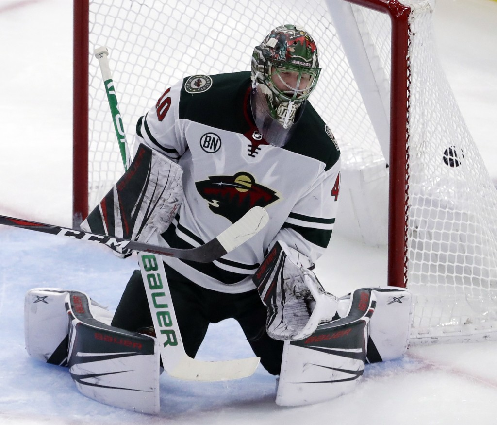 Minnesota Wild goalie Devan Dubnyk cannot stop a goal by Chicago Blackhawks Patrick Kane during the second period of an NHL hockey game Thursday, Dec....