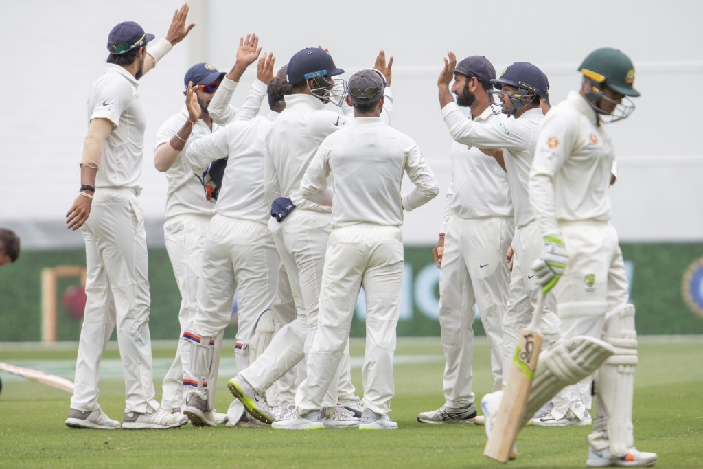 Indian team members celebrate the wickets of Australia's Usman Khawaja as he departs during play on day three of the third cricket test between India ...