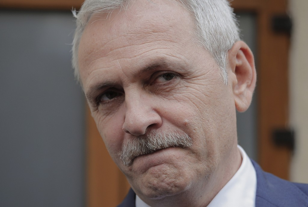 FILE - In this April 27, 2018 file photo, the leader of Romania's ruling Social Democratic party, Liviu Dragnea, walks out of the anti-corruption pros