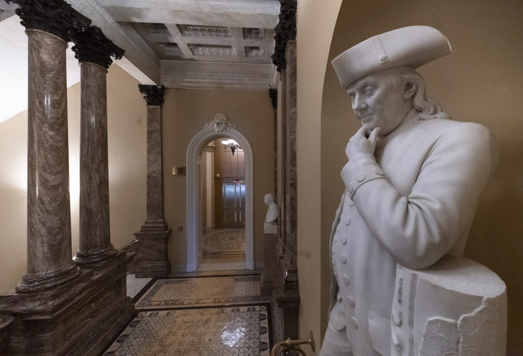 A statue of Benjamin Franklin is seen in an empty corridor outside the Senate at the Capitol in Washington, Thursday, Dec. 27, 2018, during a partial ...
