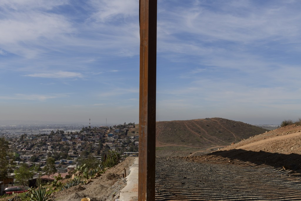Tijuana, Mexico, left, and San Diego, Calif, right, are seen separated by the U.S. border fence, on Saturday, Dec. 22, 2018. The Trump administration'...
